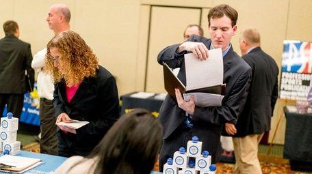 Ryan Solan of Merrick, meets with Sharon Crane