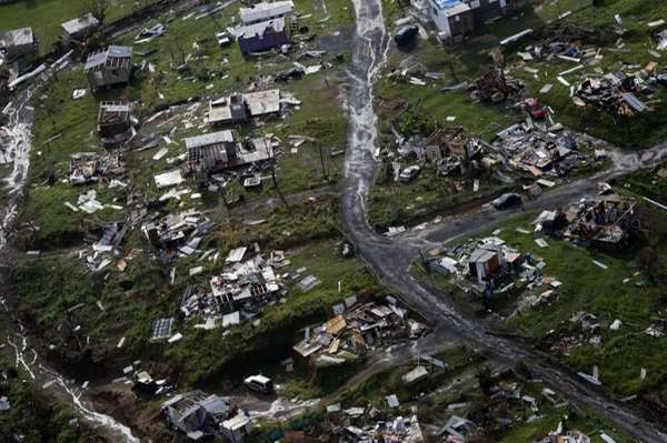 Debris is scattered across a destroyed community in