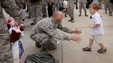 Master Sgt. Jeremiah Clarson Jr. greets his son