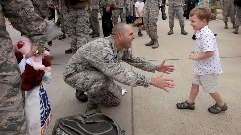Master Sgt. Jeremiah Clarson Jr. greets his son