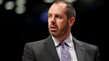 Frank Vogel of the Magic reacts against the
