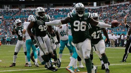 Jets defensive end Muhammad Wilkerson celebrates an interception