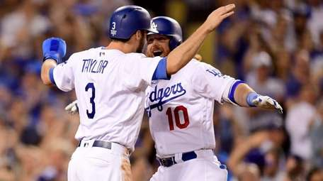 The Dodgers' Justin Turner celebrates with Chris Taylor