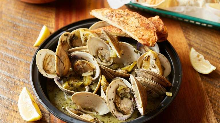 Garlic-steamed middle neck clams are served with garlic