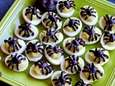 Deviled eggs made with avocado are topped with