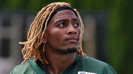Buster Skrine of the Jets looks onduring training