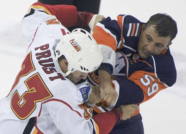 The Islanders' Michael Haley, right, fights with Calgary's