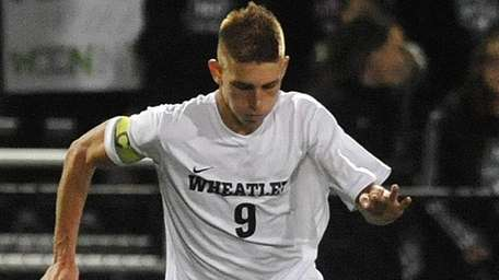 Wheatley's Nick Tagios moves theball downfield during the