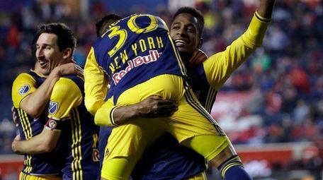 Red Bulls midfielder Gonzalo Veron celebrates with defender