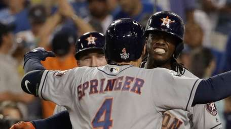 The Astros' George Springer celebrates after a two-run