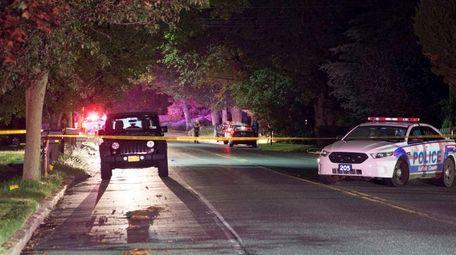 Suffolk County police investigate the scene where officials