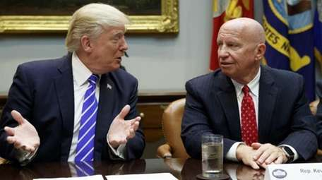 Rep. Kevin Brady, R-Texas, right, listens as President