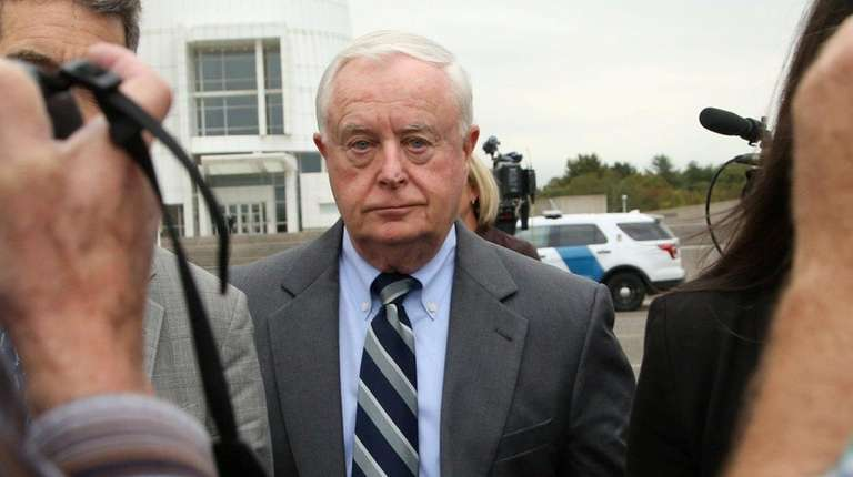 Suffolk District Attorney Thomas Spota leaves federal court