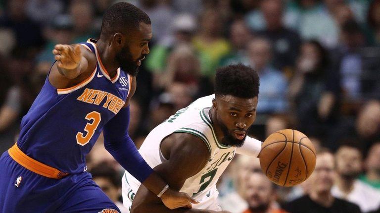 Jaylen Brown of the Celtics drives against Tim