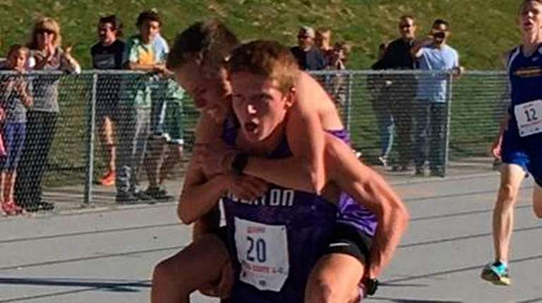 Sean Rausch carries teammate Blake Lewis, both runners