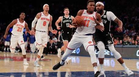 Knicks guard Frank Ntilikina drives the lane against