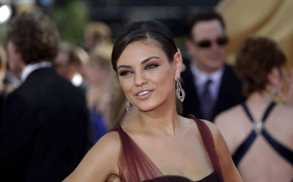 Mila Kunis arrives at the 61st Annual Primetime