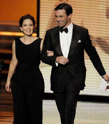 Presenters Tina Fey, left, and Jon Hamm enter