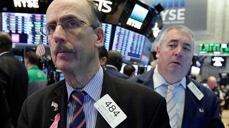 Trader Joseph Dente works on the floor of