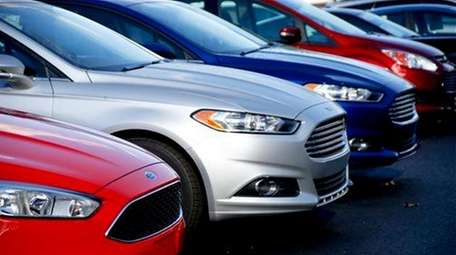 A Ford Fusion is seen on a dealership's