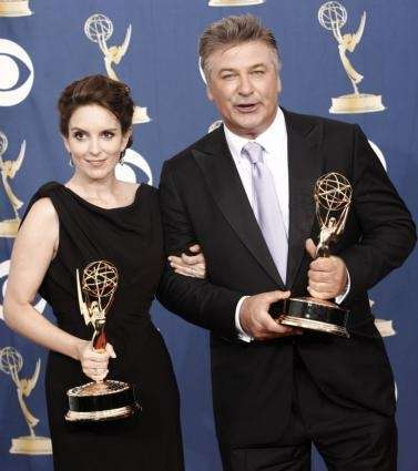 Tina Fey, left, holds the award for best