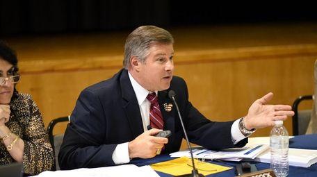 Massapequa Deputy Superintendent Alan Adcock speaks at a