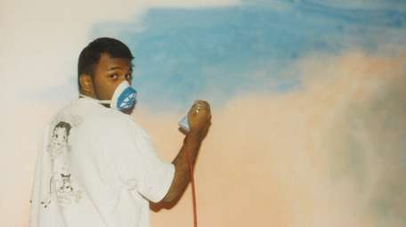 At age 16, Lenny Achan painted a mural