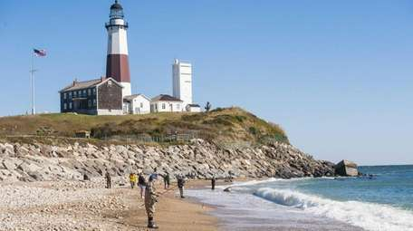 Surfcasters fish for striped bass at the Montauk