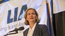 Laura Curran's challenges include restoring public trust in