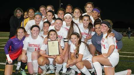 Southold/Greenport players celebrate their win during in the
