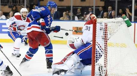 J.T. Miller of the Rangers takes a shot
