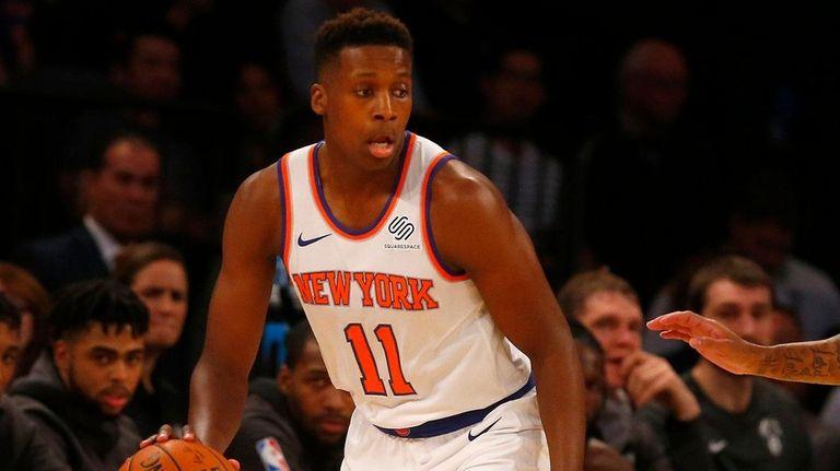 Knicks guard Frank Ntilikinacontrols the ball in the