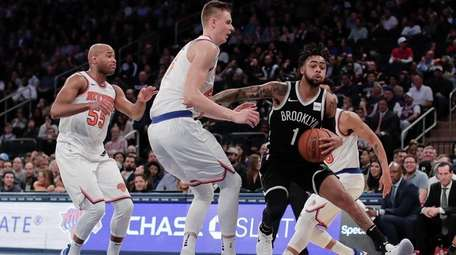 Nets guard D'Angelo Russelldrives to the basket against
