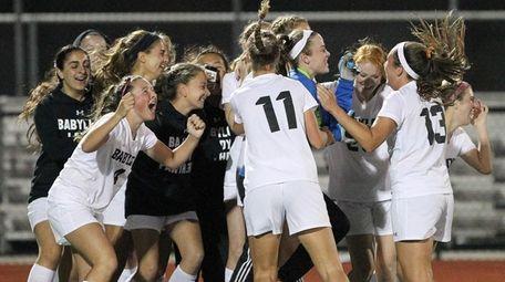 The Babylon girls soccer team celebrates its win