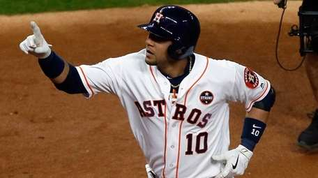 Astros first baseman Yuli Gurrielreacts after hitting a
