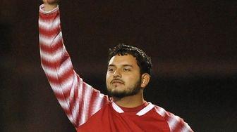 Uniondale goalie Jose Romero gestures toward fans moments