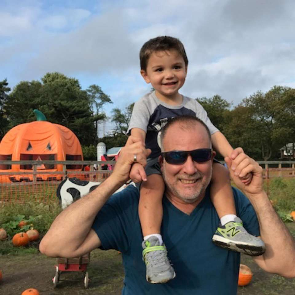 Grandpa and Luke pumpkin picking