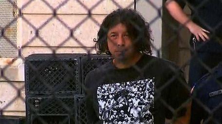 Luis De Jesus, 42, is escorted out of