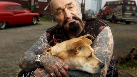 Rescue Ink member Batso and his dog Inka