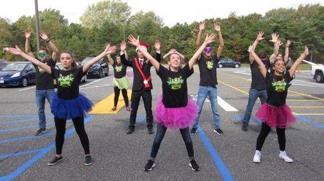 Connetquot High School senior Emily Monahan, center, leads
