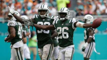 Jets safeties Marcus Maye and Jamal Adams celebrate Maye's interception during a