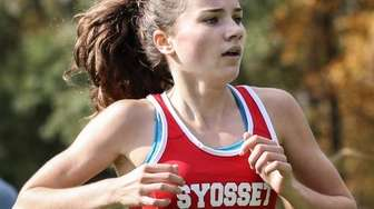 Reilly Siebert of Syosset crosses the finish line