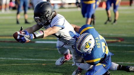 Centereach wide receiver Jesse Distasio (10) puts the