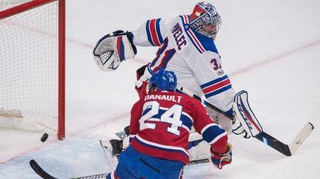 Montreal Canadiens' Phillip Danault scores against New York