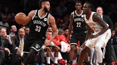 Brooklyn Nets guard Allen Crabbe controls the ball