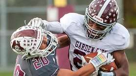 Mepham's Nick Cucinella (20, left) tries to tackle