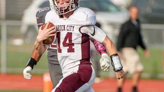 Garden City quarterback Colin Hart (14) runs the