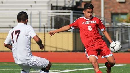 Southold's Mario Contreras lines up the ball while