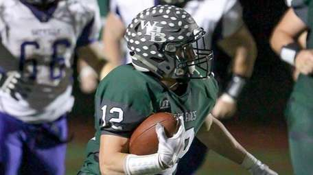 Westhampton's Dylan Laube breaks a tackle and runs