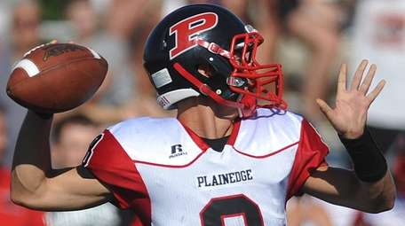 Plainedge quarterback Mike Ciuffo throws a pass during a